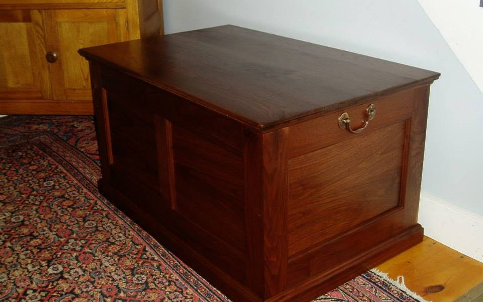 A frame and panel walnut toybox with bookmatched panels