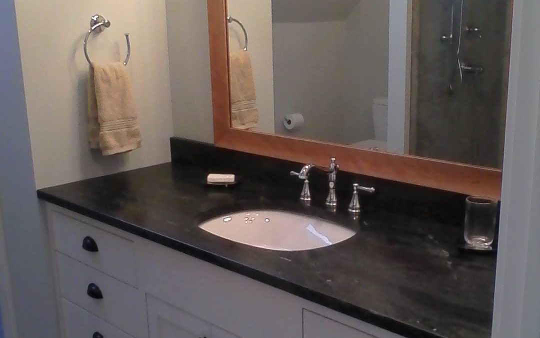 Large white vanity with slab drawer fronts and shaker panel doors.