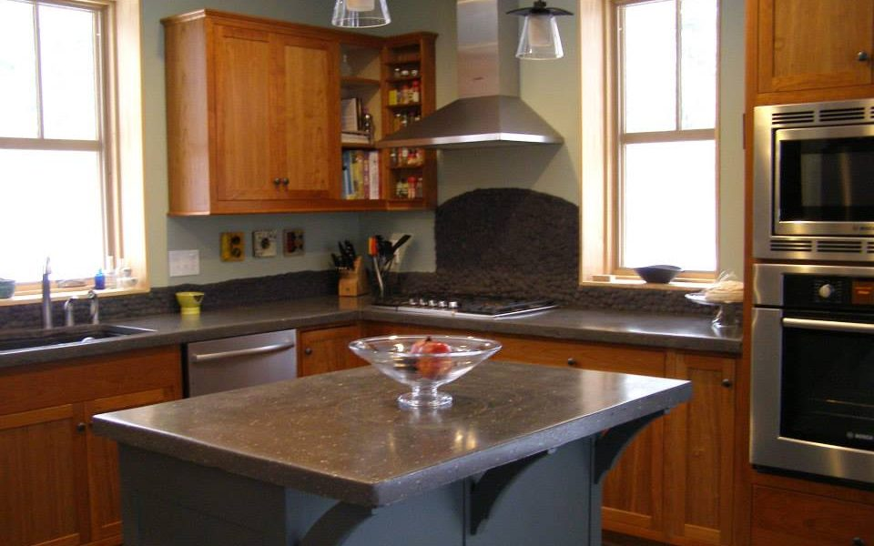 A painted island is a great way to lend some contrast to a warm cherry kitchen.