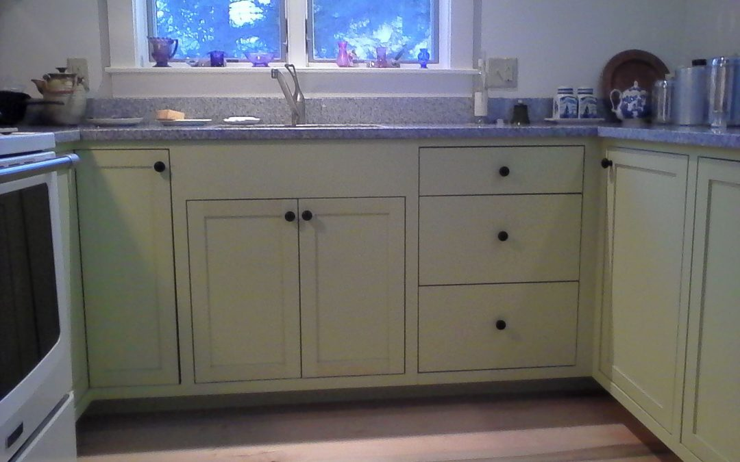 A small painted kitchen is just big enough for a guest house.