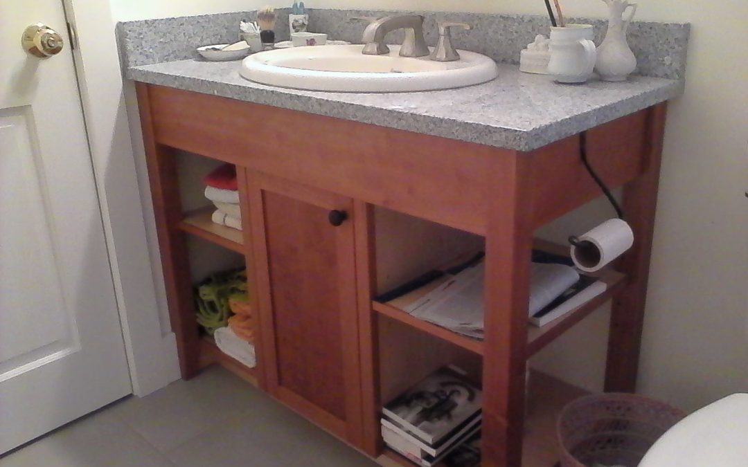 A modified open stand cherry vanity.