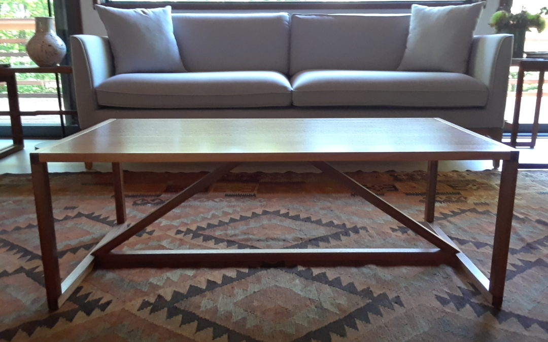 A slender, modernist mahogany coffee table.